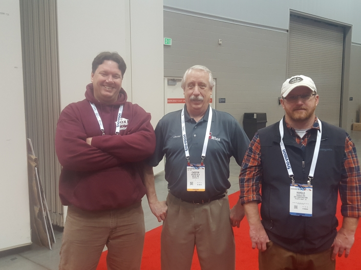 Harold & Greg from Cox Construction stop by the HotJet USA Booth (posing with Chester - center - from HotJet USA).